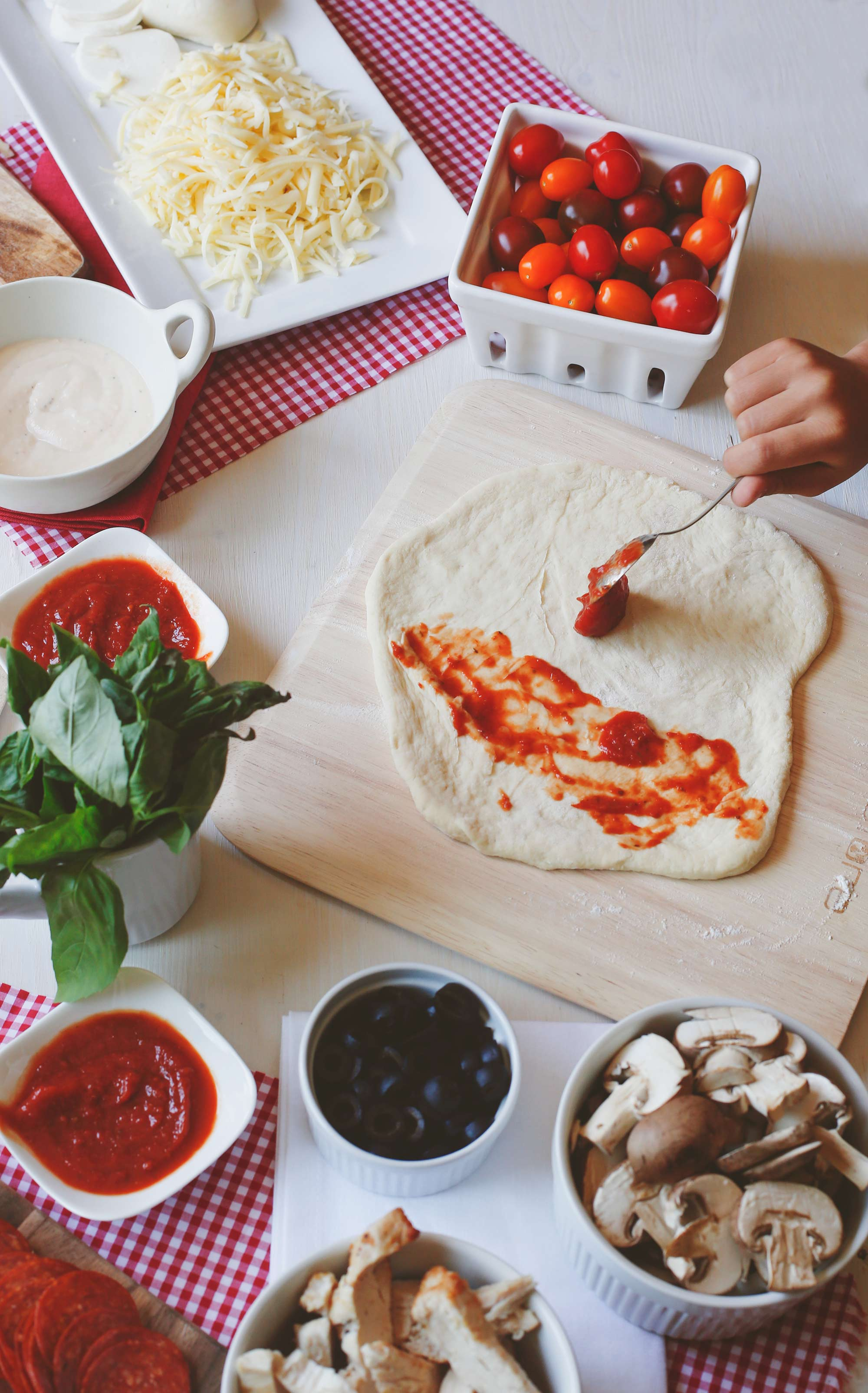 Pizza-Party-Adding-Sauce