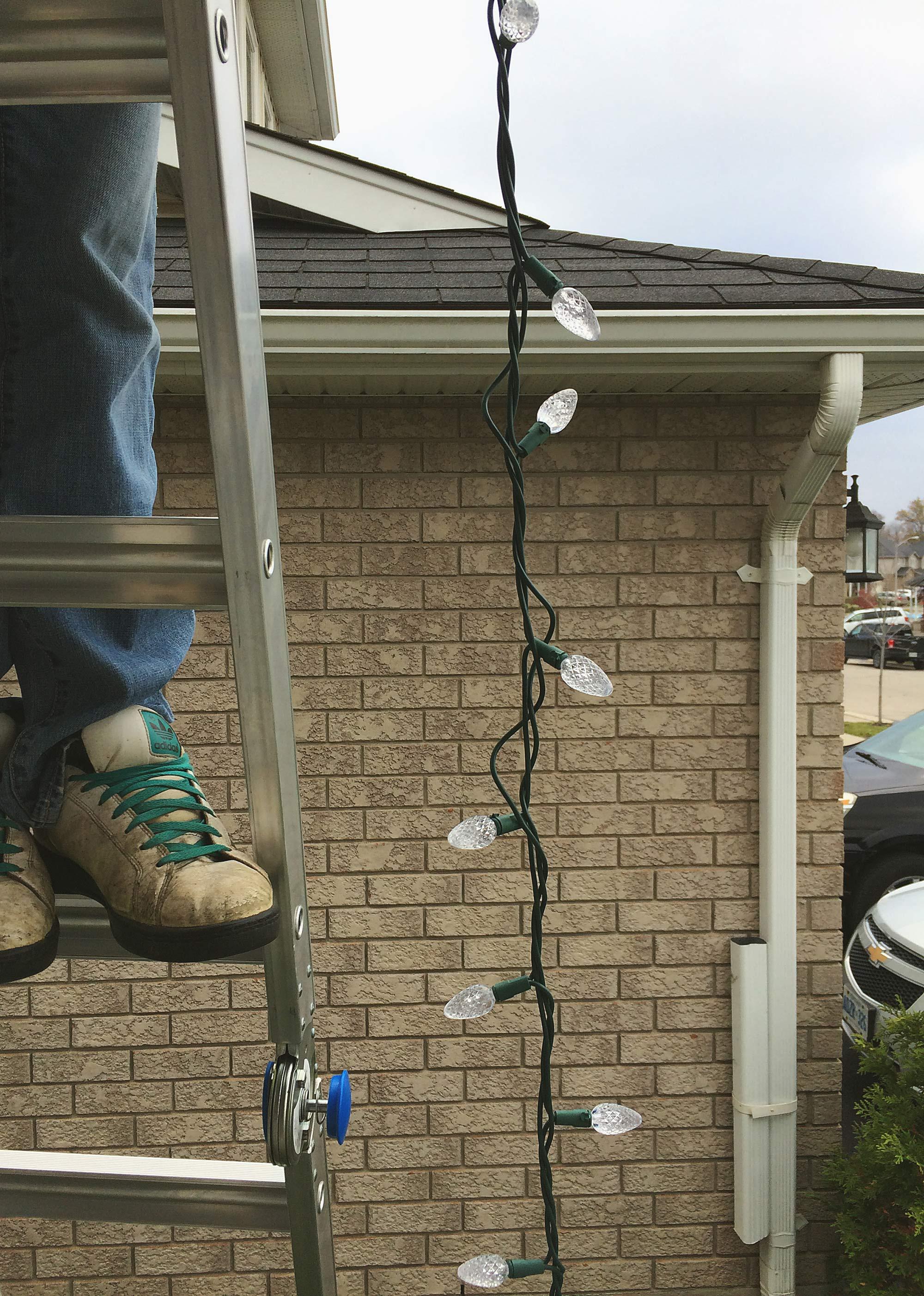 installing-christmas-lights-warm-led
