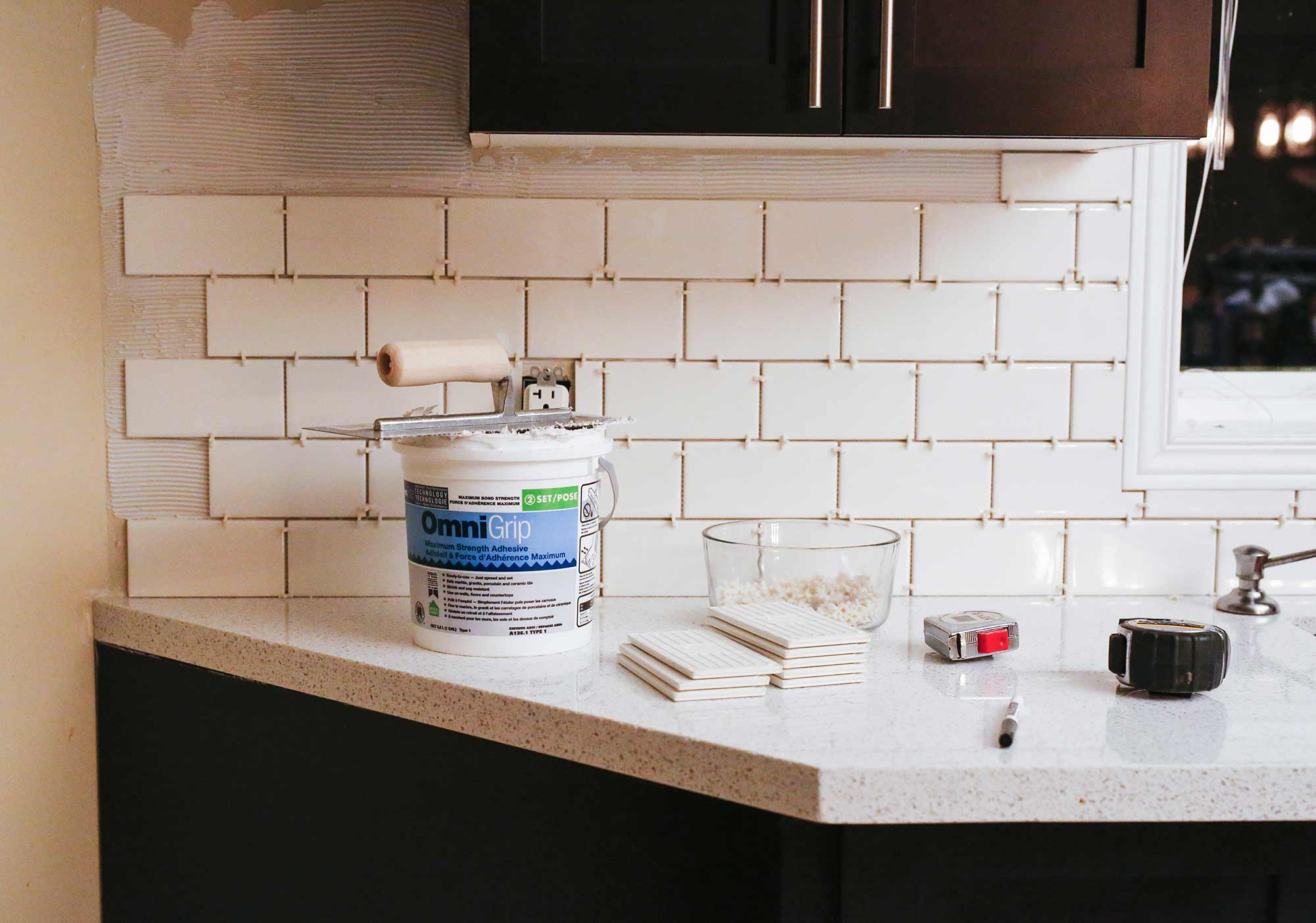 How we installed our subway tile backsplash brittany stager how to diy a subway tile backsplash dailygadgetfo Choice Image