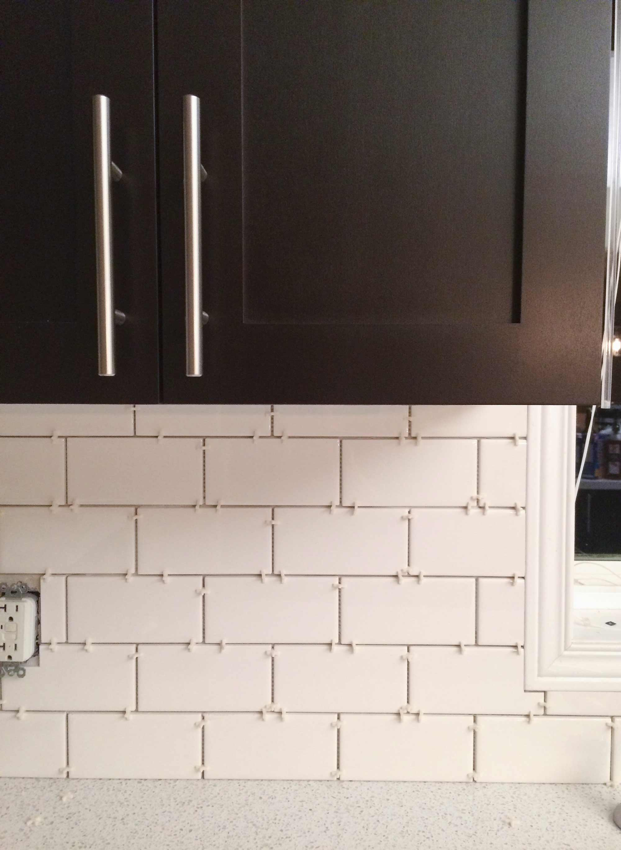 How we installed our subway tile backsplash brittany stager how to diy a subway tile backsplash dailygadgetfo Image collections