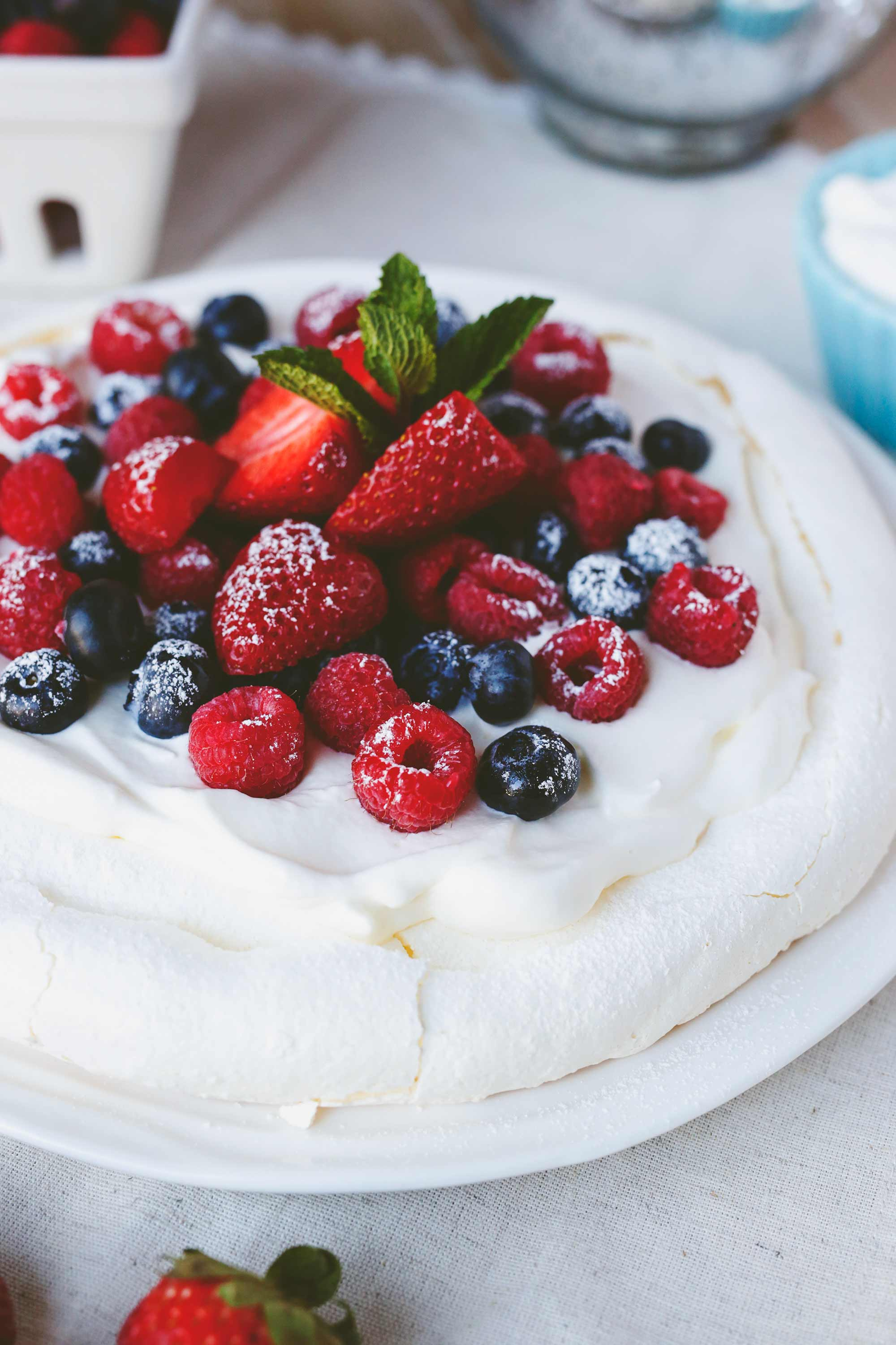 Pavlova with Fresh Berries and Whipped Cream