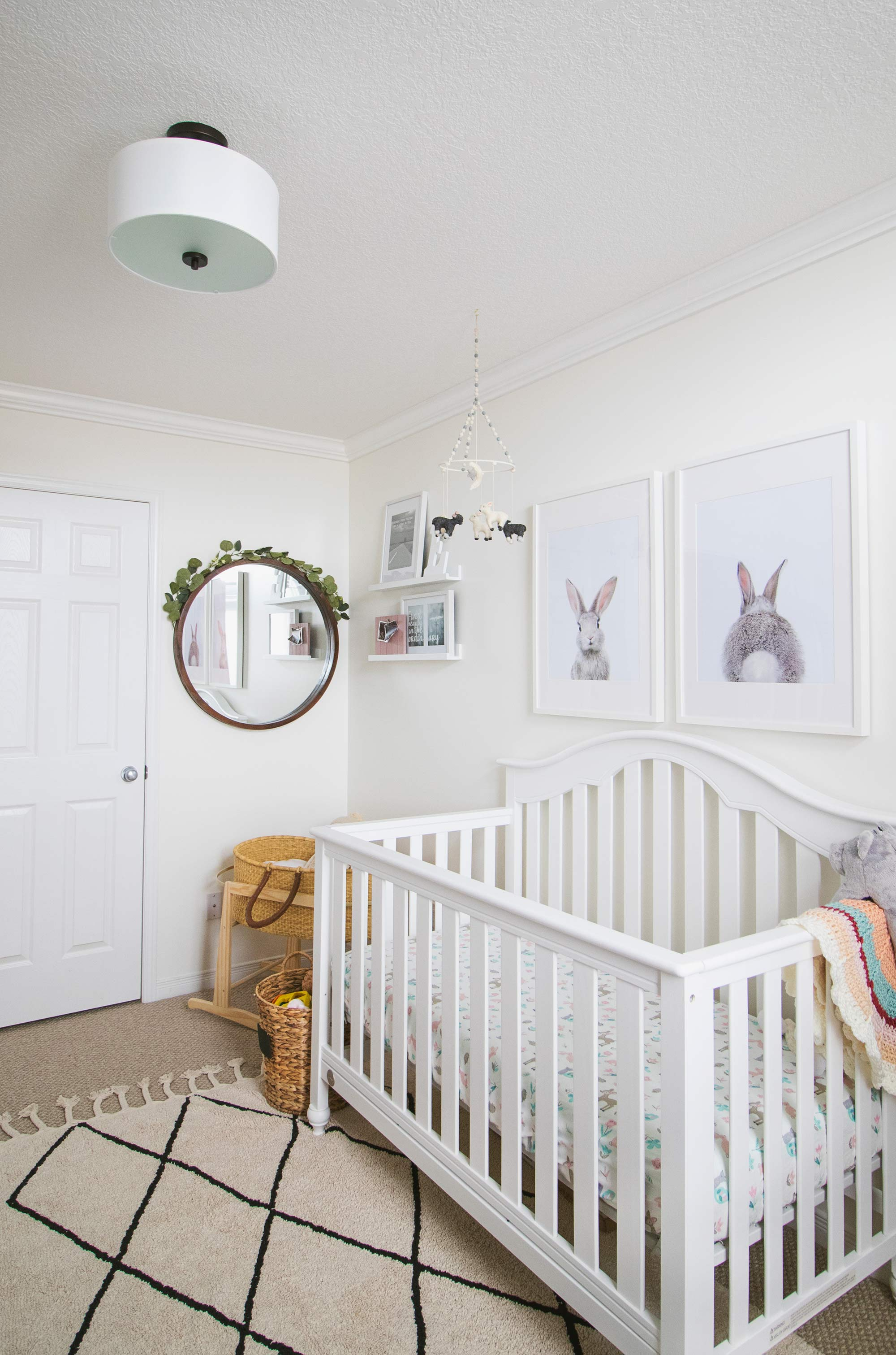 Simple and white decor for a baby girl nursery