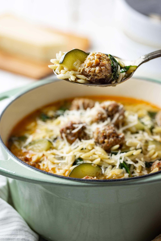 Pork meatball on spoon from Italian Meatball & Orzo Soup