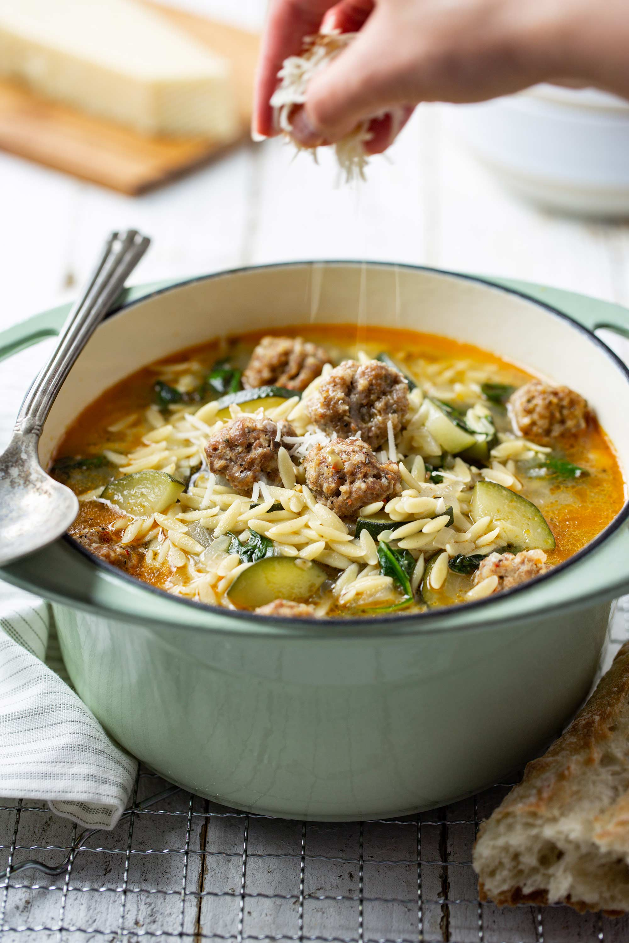 Italian Meatball & Orzo Soup sprinkled with Parmesan Cheese