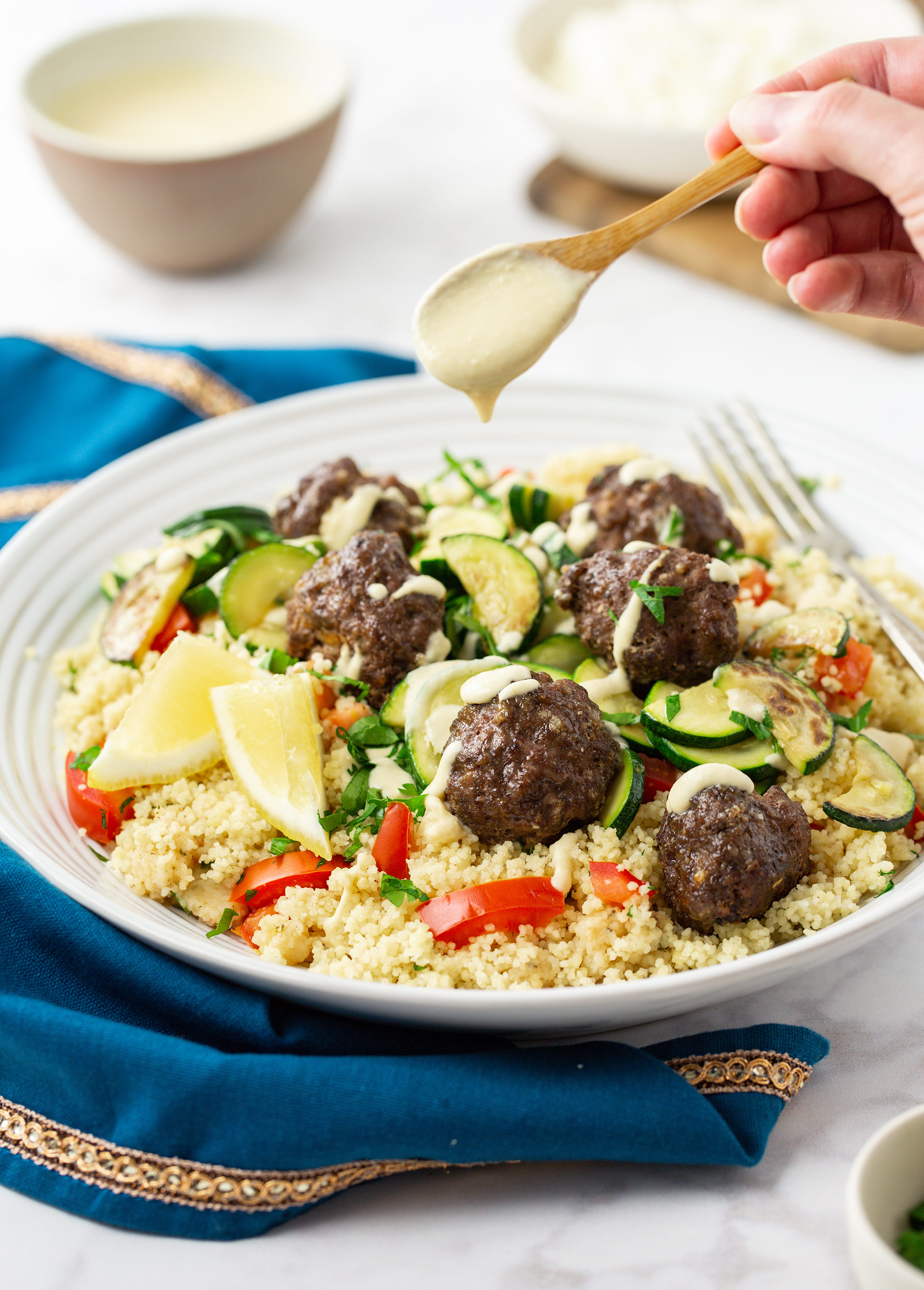 Lebanese Beef & Feta Meatballs with Zucchini, Couscous Tabbouleh and Hummus Drizzle